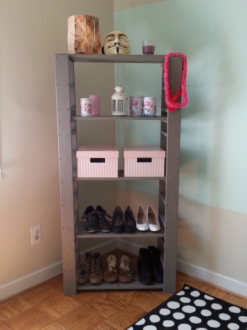 This is an upcycled Shelf. Damian and I found it on the side of the road-it was bare wood and obviously just an outdoor garden shelving unit. I painted it gray and tightened it up! I love the way it turned out!